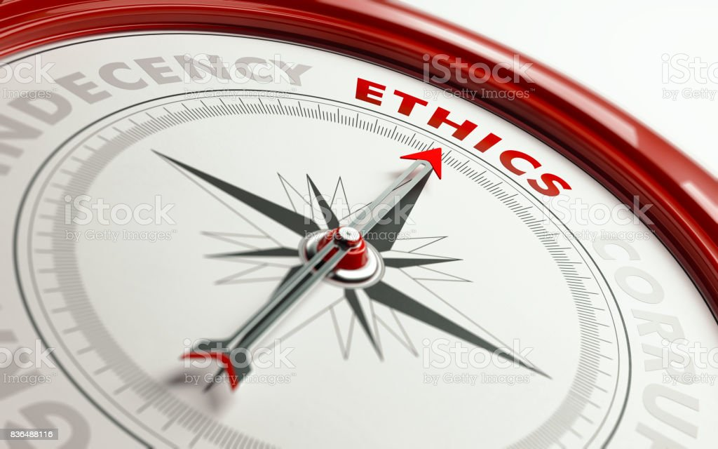 Ethics Concept: Arrow of A Compass Pointing Ethics Text stock photo