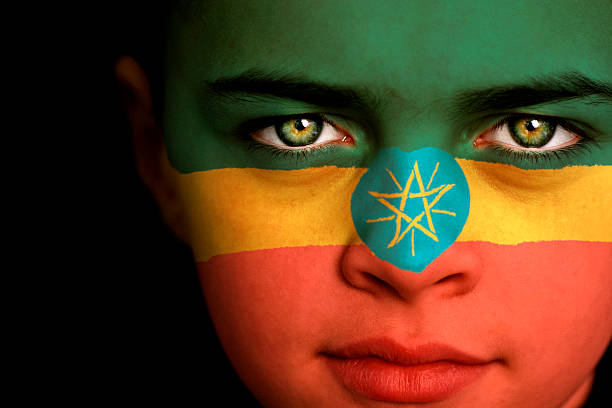 ethiopia flag boy - ethiopian flag stock photos and pictures
