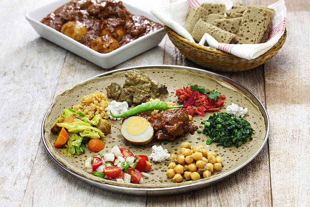 ethiopian cuisine - horn of africa stock photos and pictures