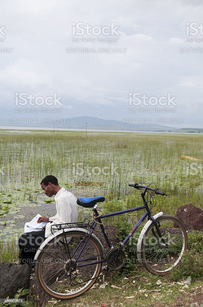 Ethiopian man beside his bicycle at Lake Awasa stock photo