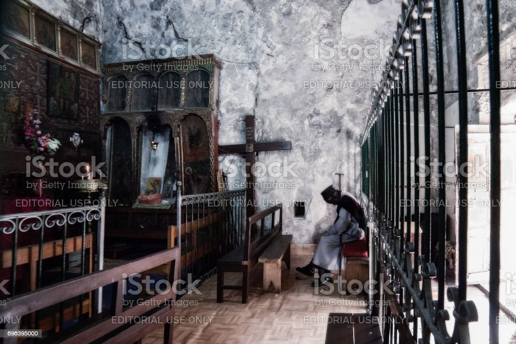 Ethiopian monk in the Church of Holy Sepulchre in Jerusalem stock photo