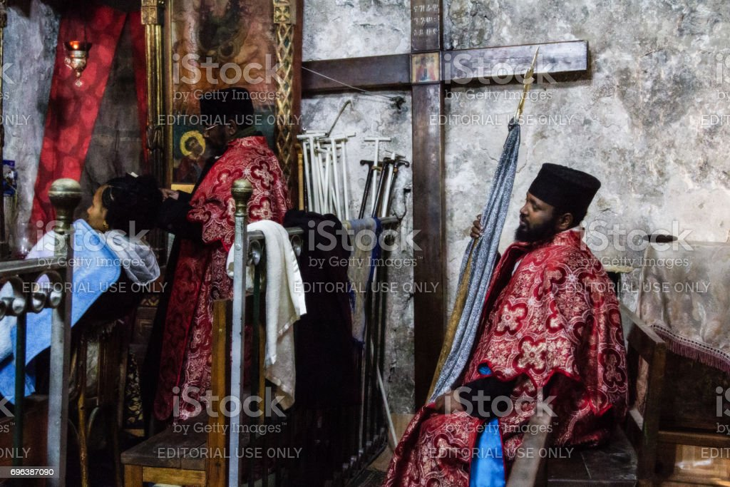Ethiopian monks in the Church of Holy Sepulchre in Jerusalem stock photo