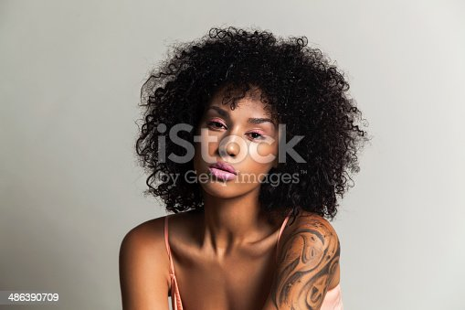 istock Ethnic beauty with pink eye shadow 486390709