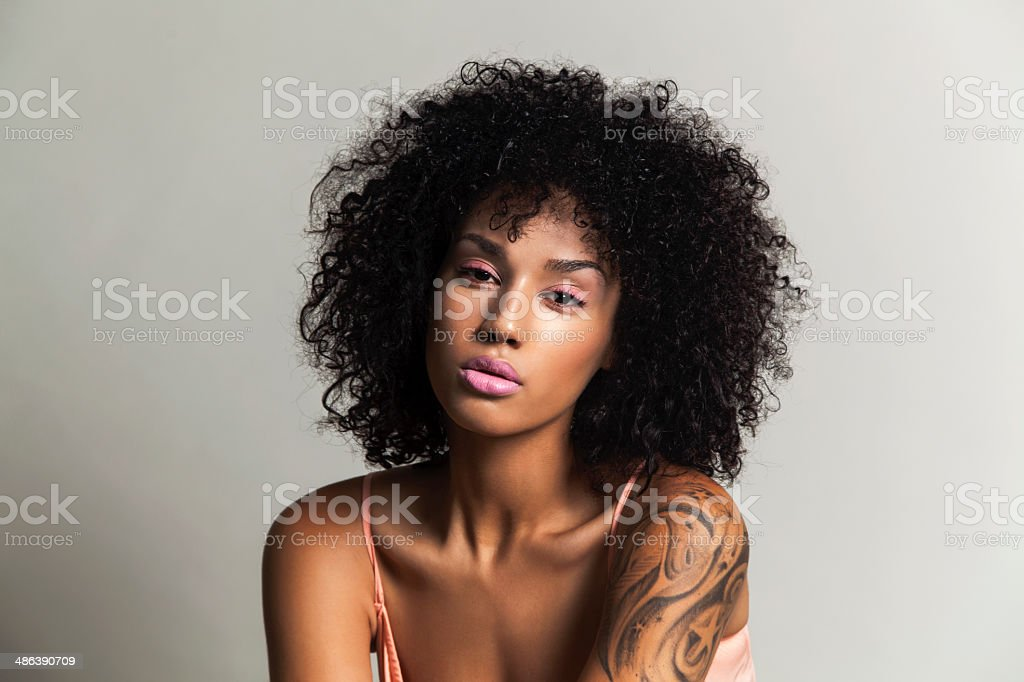 Ethnic beauty with pink eye shadow stock photo