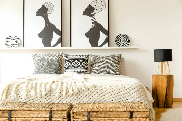 ethnic bed with pillows - home decor boho imagens e fotografias de stock