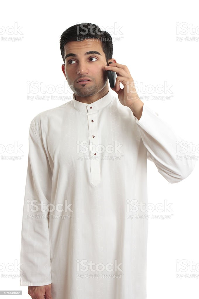 Ethnic businessman on cellphone royalty-free stock photo