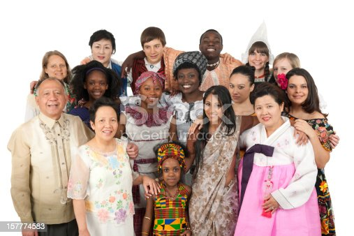 A large diverse group of people wearing traditional ethnic clothing. Korean, East Indian, Kenyan Filipino, Spanish, Jamaican, Dutch, Finnish, German, and more
