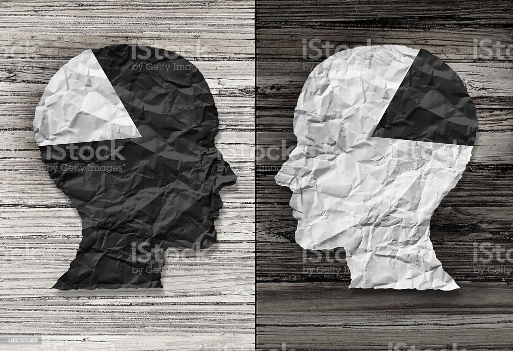 Ethnic Equality Ethnic equality concept and racial justice symbol as a black and white crumpled paper shaped as a human head on old rustic wood background with contrasting tones as a metaphor for social race issues. 2015 Stock Photo