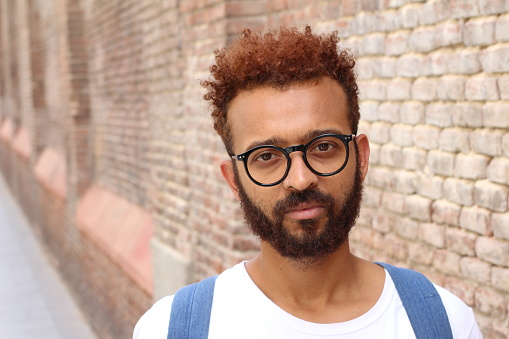 istock Ethnic exotic male with glasses 1012644348