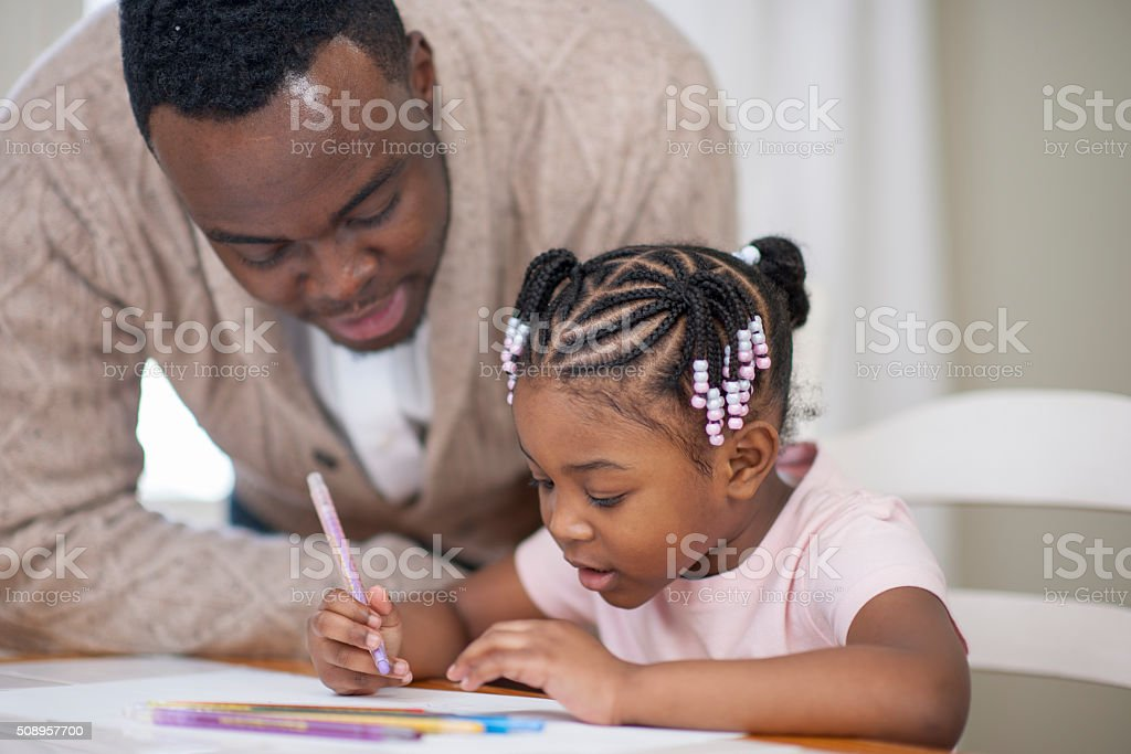 Ethnic Father Helping Her Daughter Learn Art stock photo