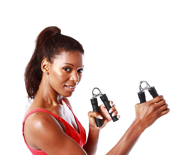 ethnic female with handgrips - hand grip stock photos and pictures