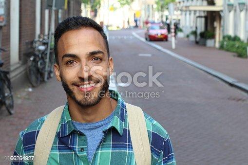 Ethnic man smiling on the street.