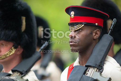 3rd May, 2019 - Ethnic member of of the Queen's Guard taking orders from their sergeant, practicing their marching in Horse Guards road, Westminster, London, UK