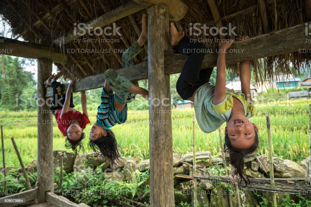 Ethnic minority children playing outdoor in Y Ty, Bat Xat district stock photo