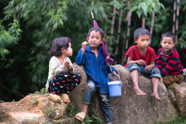 Ethnic minority, Hmong children playing in tradition village at Sapa town, Vietnam stock photo