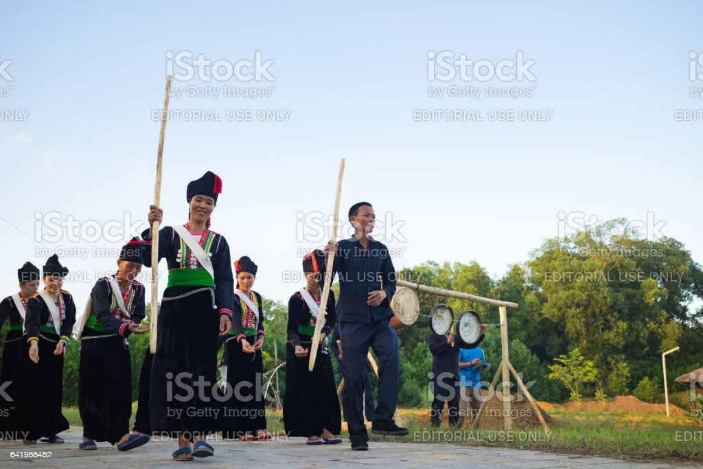 Hanoi, Vietnam - Nov 15, 2015: Ethnic minority people perform traditional dance praying for rain in Village of Vietnamese ethnic groups in Dong Mo, Son Tay stock photo