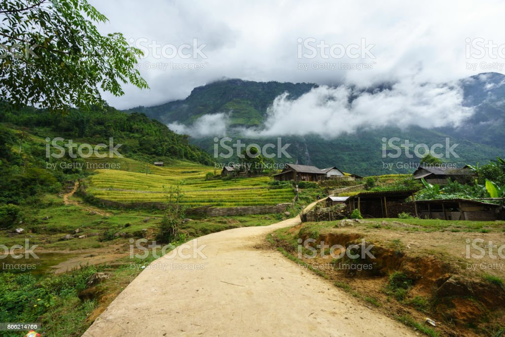Ethnic minority village with road, houses, terrace rice field in Y Ty, Lao Cai, north Vietnam stock photo