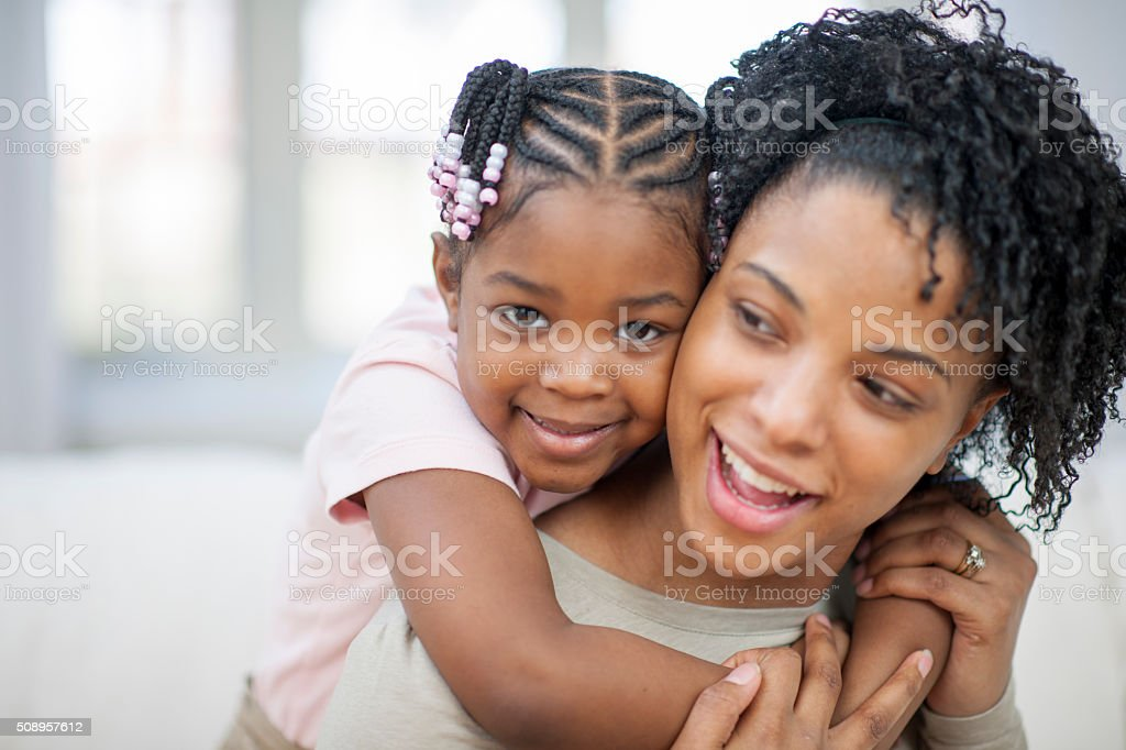 Ethnic Mother and Daughter Playing Together stock photo