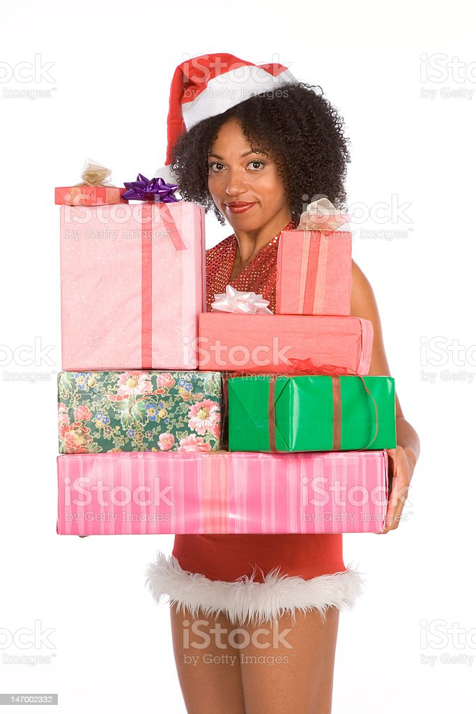 Ethnic Mrs Santa with pile of Christmas presents royalty-free stock photo