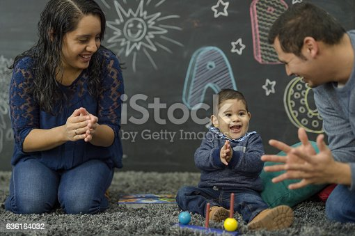 istock Ethnic parents reading with their toddler in a home playroom 636164032