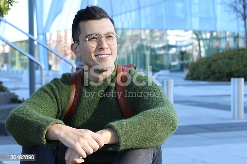 Ethnic student male smiling on campus.