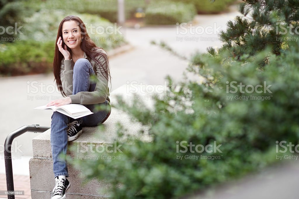 Ethnic student on the phone royalty-free stock photo