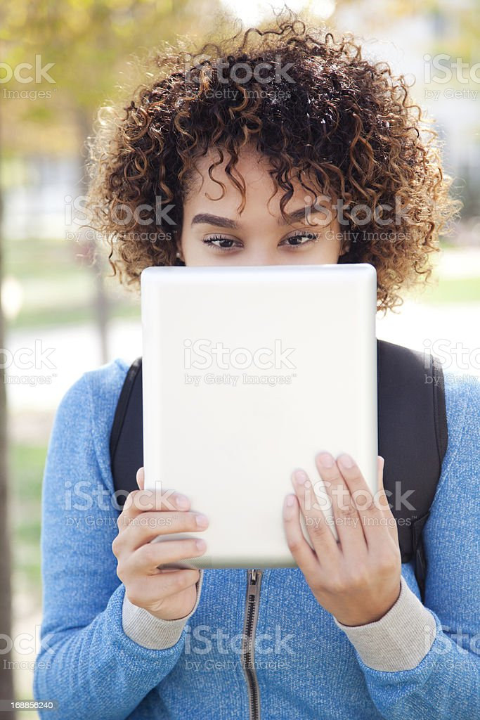 Ethnic student using a digital tablet royalty-free stock photo