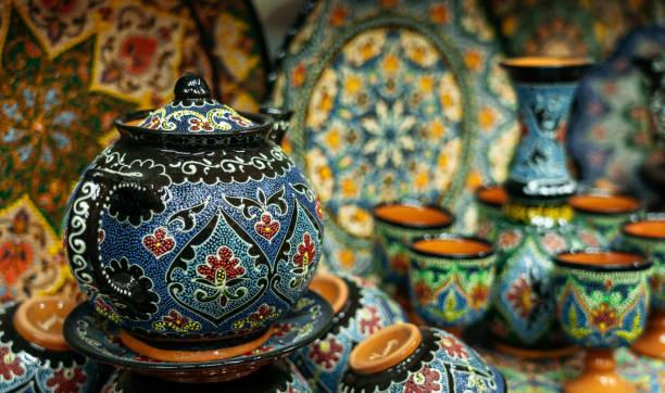 Ethnic Uzbek ceramic tableware with traditional uzbekistan ornament. stock photo