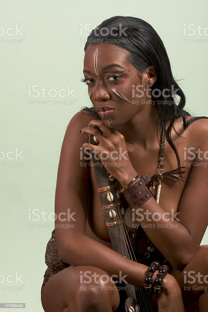 Ethnic woman musician with tribal string instrument royalty-free stock photo