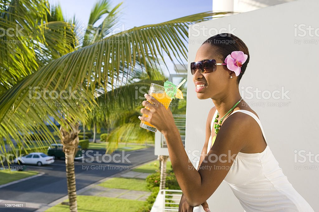 Ethnic Woman Relaxing with Drink in Hand royalty-free stock photo