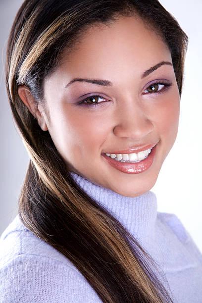 ethnic woman smiling stock photo