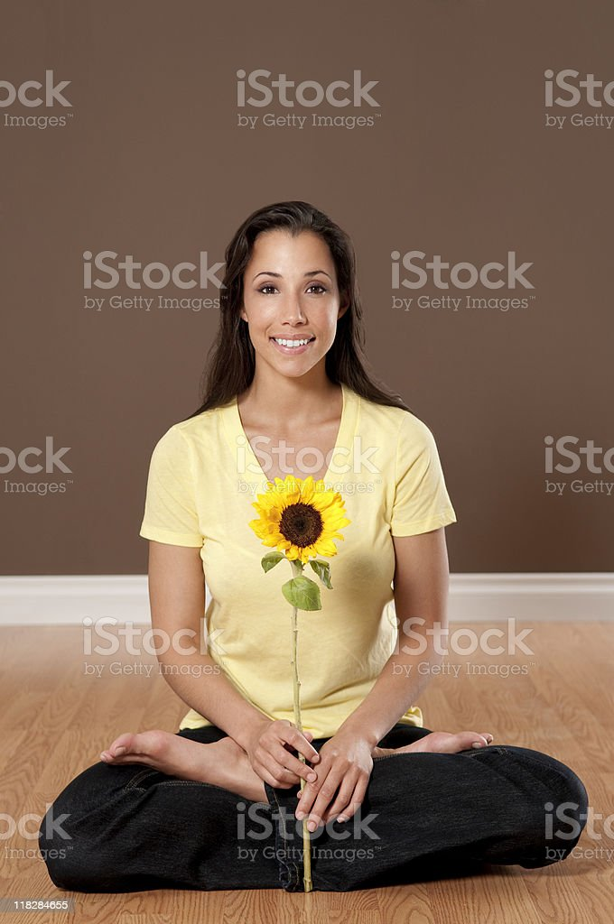 Ethnic Woman With Sunflower In Yoga Position royalty-free stock photo
