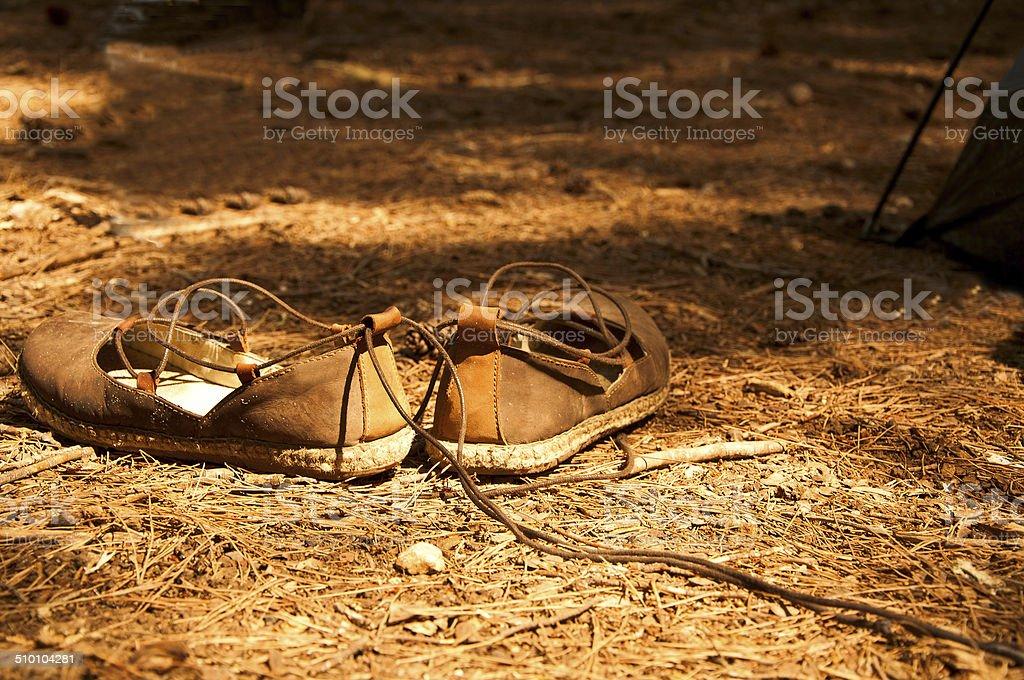 Ethnical shoes in pinewood, Melpignano, Apulia. stock photo