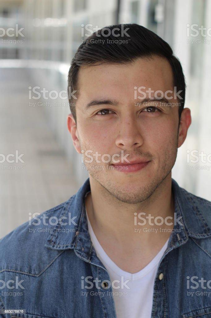 Ethnically ambiguous male close up stock photo