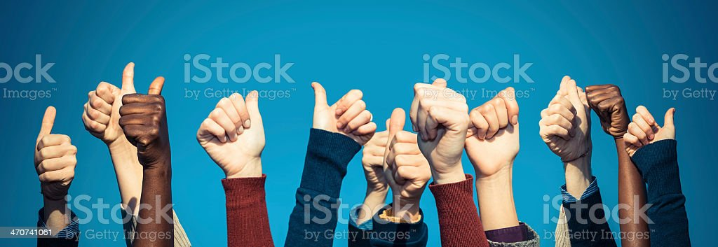 Ethnically diverse crowd of thumbs up stock photo