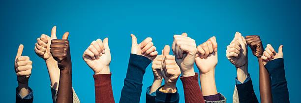 ethnically diverse crowd of thumbs up - voting hands stockfoto's en -beelden