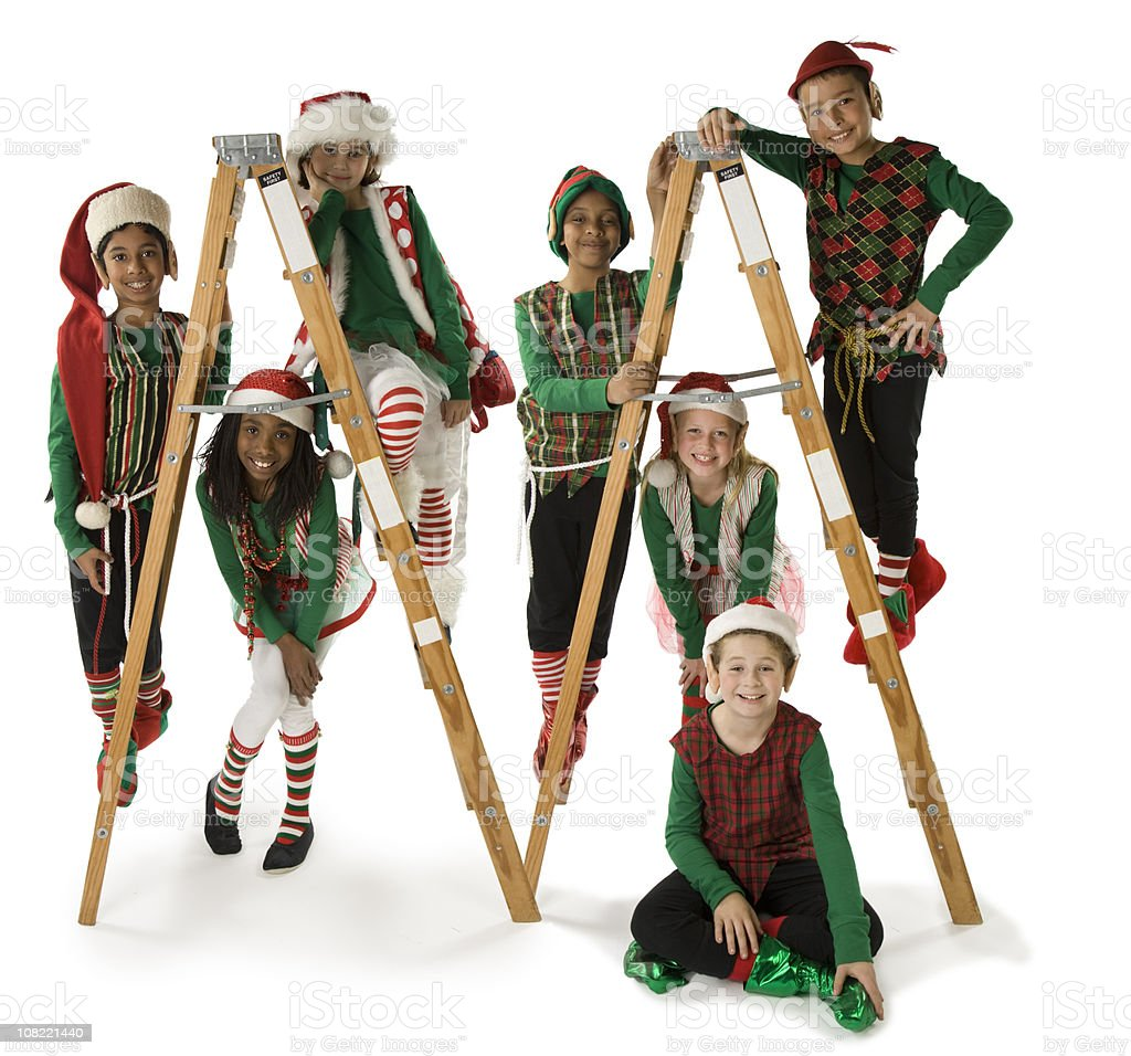 Ethnically Diverse Group of Christmas Elves on Ladders stock photo