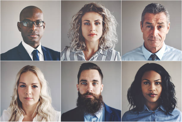 Ethnically diverse group of focused businessmen and businesswomen stock photo