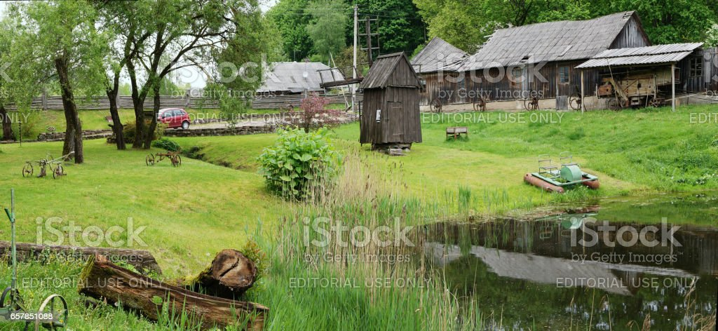 VILNIUS, LITHUANIA - MAY 15, 2016: Ethnographic museum of a retro agricultural equipment , tools and buildings in the territory of an old windmill. It is Pilaitie area- the most forest and lake district of the Lithuanian city. stock photo