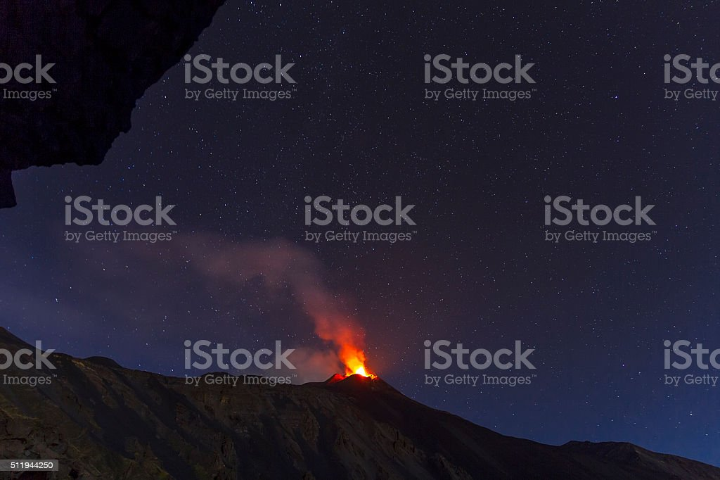 Etna eruption at night with a beautiful starry sky stock photo
