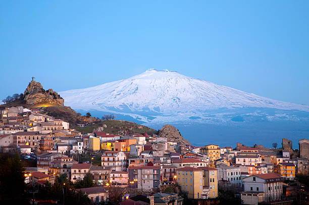 Etna Volcano View of the village of San Teodoro and Etna volcano on background. Sicily, Italy. sicily stock pictures, royalty-free photos & images