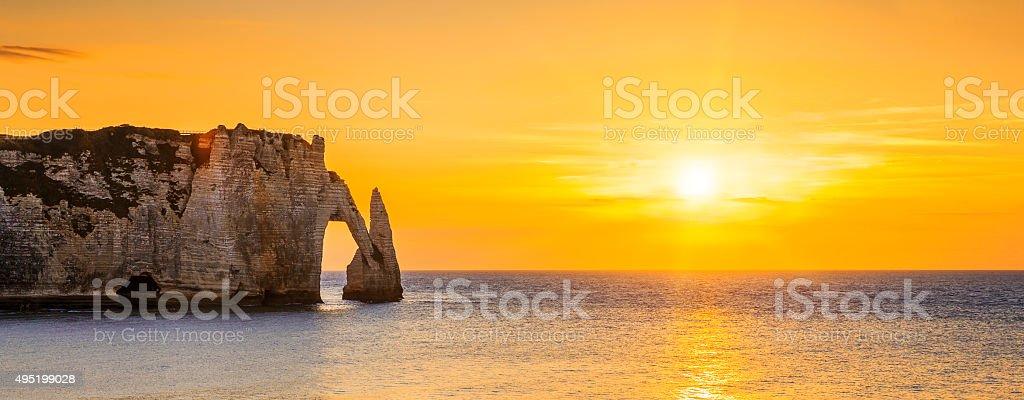 Etretat Aval cliff at sunset stock photo