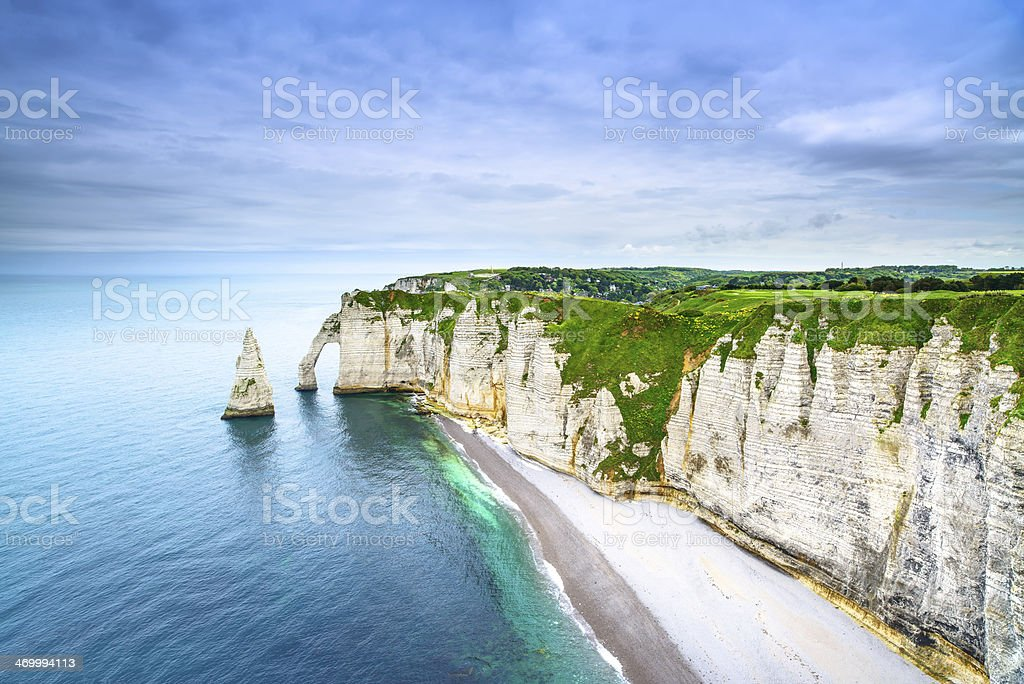 Etretat Aval cliff  rocks landmark and ocean . Normandy, France. stock photo