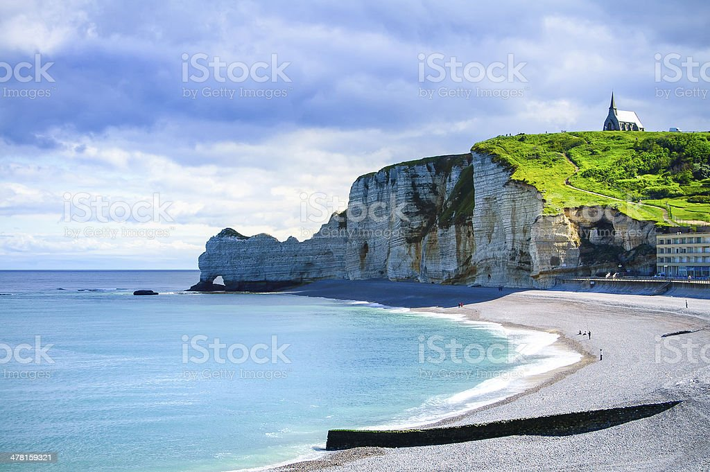 Etretat cliff, church landmark and beach on morning. Normandy, F stock photo