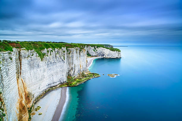 Etretat, rock cliff and beach. Aerial view. Normandy, France Etretat, rock cliff and beach. Long exposure photography. Aerial view. Normandy, France. le havre stock pictures, royalty-free photos & images