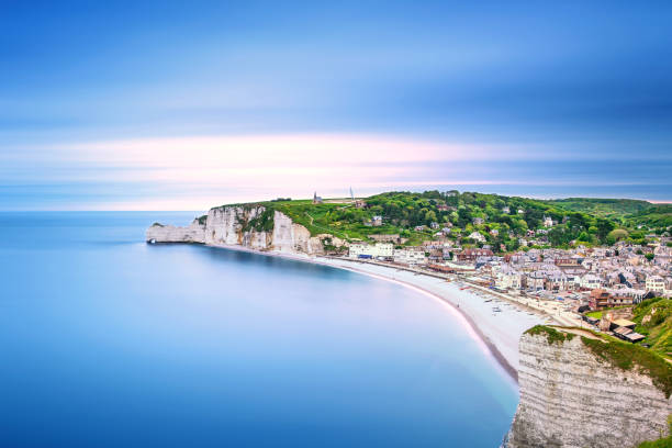 Etretat village. Aerial view from the cliff. Normandy, France. Etretat village and its bay beach, aerial view from cliff. Normandy, France, Europe. Long exposure photography normandy stock pictures, royalty-free photos & images