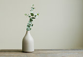 istock Eucalyptus branch in a vase on the rustic wooden table 1187202343