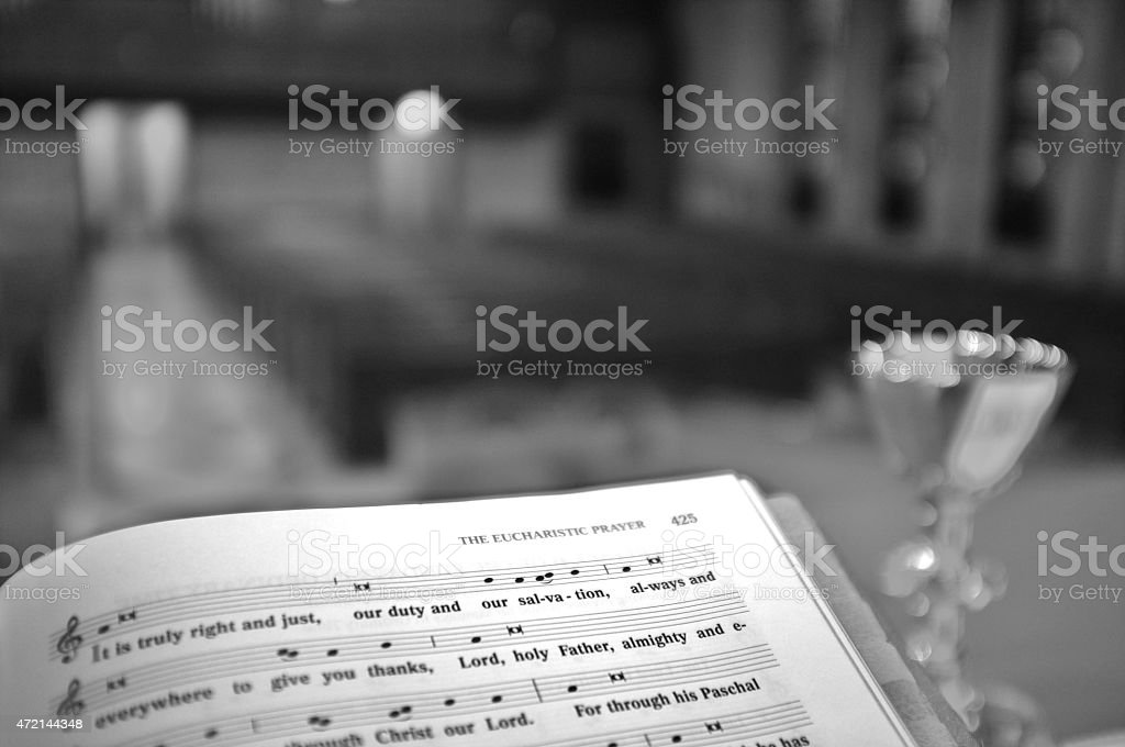 Eucharistic Bible Liturgy and Chalice for Mass Service in Church stock photo
