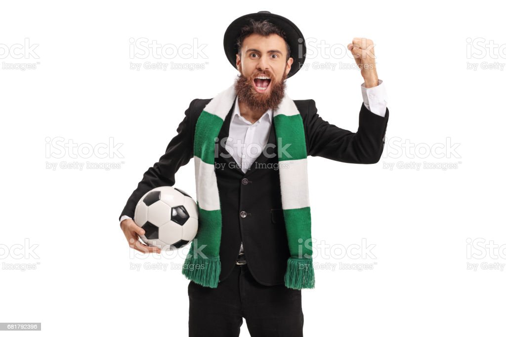 Euphoric football fan with a scarf cheering stock photo