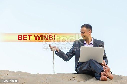 843298172 istock photo Euphoric happy businessman wear suit celebrate mobile win, 1205778346